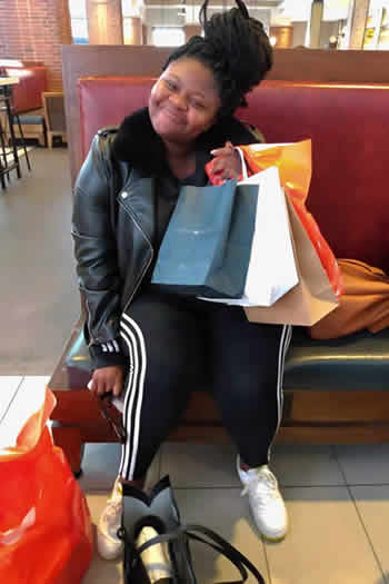 Sneziey Msomi shopping in Woodbury, New York