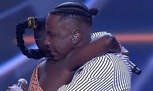Ndoni Mseleku hugs Brandon Dhludhlu during the Idols SA 2020 Top 4 Reveal Live Show