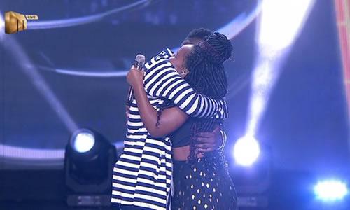 Brandon Dhludhlu and Zama Khumalo hug each other after Brandon's elimination from Idols SA season 16
