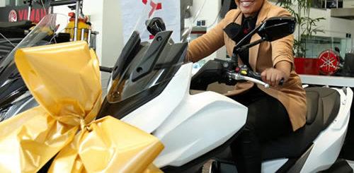 Zama Khumalo receives her Kymco scooter Idols SA prize from Yamaha
